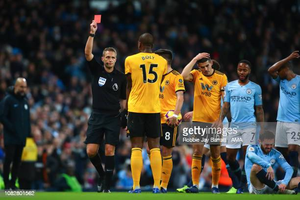 Willy Boly of Wolverhampton Wanderers is show a red card during the Premier League match between Manchester City and Wolverhampton Wanderers at...