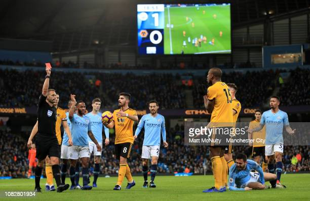 Willy Boly of Wolverhampton Wanderers is shown a red card and is sent off by referee Craig Pawson during the Premier League match between Manchester...