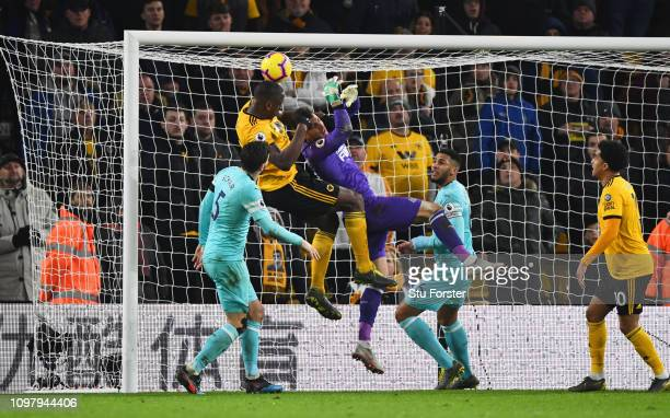 Willy Boly of Wolverhampton Wanderers outjumps goalkeeper Martin Dubravka of Newcastle United as he scores his team's first goal during the Premier...