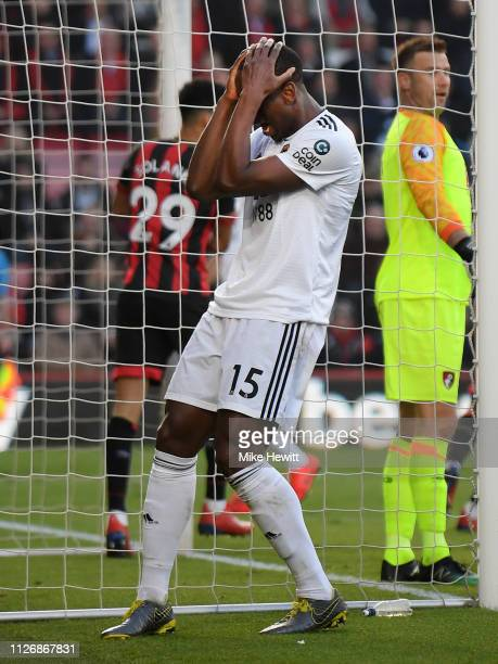 Willy Boly of Wolverhampton Wanderers reacts after missing a chance during the Premier League match between AFC Bournemouth and Wolverhampton...