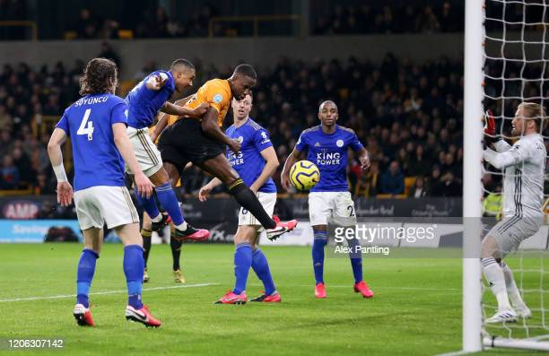 Willy Boly of Wolverhampton Wanderers scores his sides first goal which is then ruled offside by VAR during the Premier League match between...