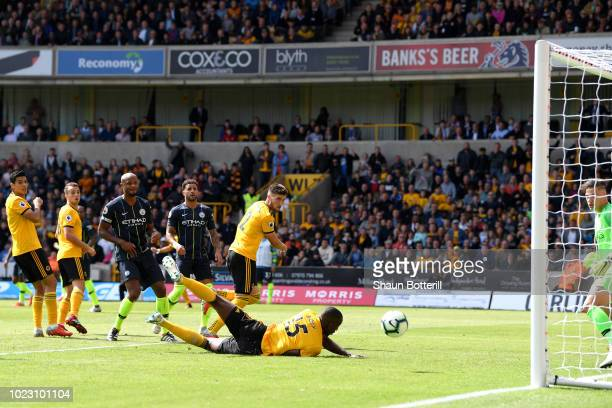 Willy Boly of Wolverhampton Wanderers scores his side's first goal during the Premier League match between Wolverhampton Wanderers and Manchester...