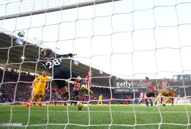Willy Boly of Wolverhampton Wanderers scores his team's first goal past Angus Gunn of Southampton during the Premier League match between Southampton...