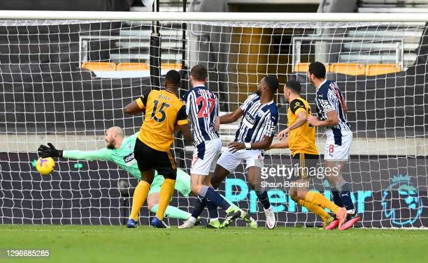 Willy Boly of Wolverhampton Wanderers scores his team's second goal past David Button of West Bromwich Albion during the Premier League match between...
