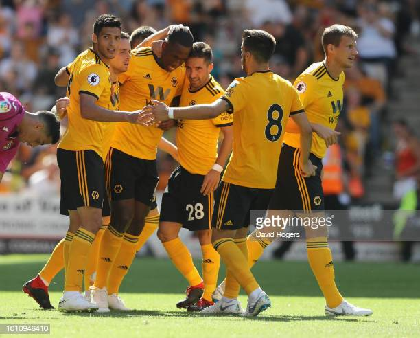 Willy Boly of Wolverhamton Wanderers celebrates with team mates after scoring their first goal during the preseason friendly match between...