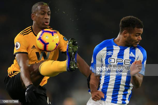 Willy Boly of Wolves battles with Steve Mounie of Huddersfield during the Premier League match between Wolverhampton Wanderers and Huddersfield Town...