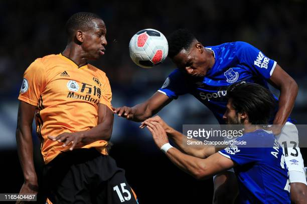 Willy Boly of Wolves battles with Yerry Mina of Everton during the Premier League match between Everton and Wolverhampton Wanderers at Goodison Park...