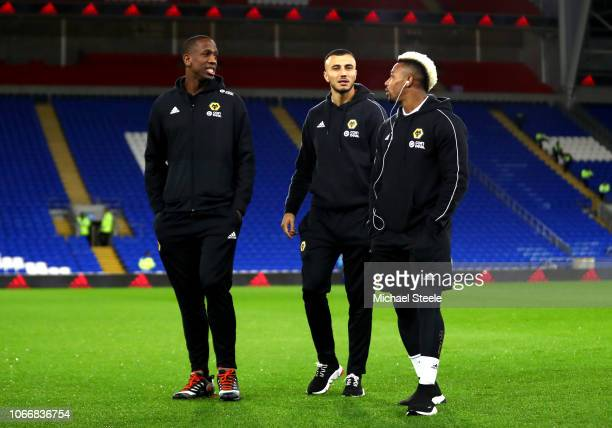 Willy Boly Romain Saiss and Adama Traore of Wolves inspect the pitch ahead of the Premier League match between Cardiff City and Wolverhampton...