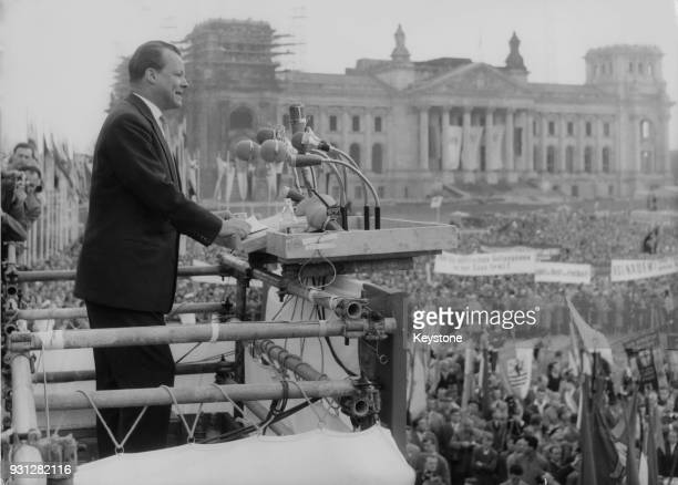 Willy Brandt the Governing Mayor of West Berlin addresses the crowds on May Day in front of the Reichstag in the Platz der Republik Berlin Germany...