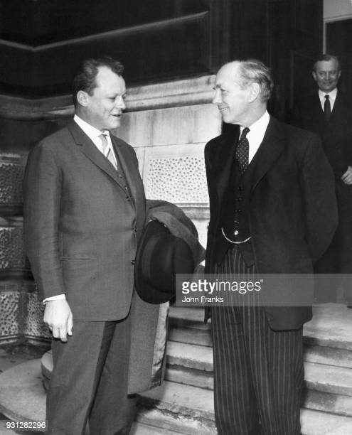 Willy Brandt the Governing Mayor of West Berlin with British Foreign Secretary Lord Alec DouglasHome after a luncheon at Lord Home's house in Carlton...