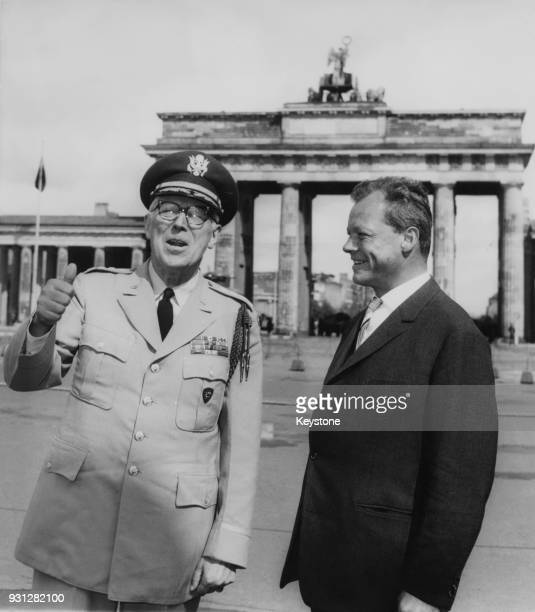 Willy Brandt the Governing Mayor of West Berlin with General Bruce C Clarke CommanderinChief of the US Army in Europe in front of the Brandenburg...