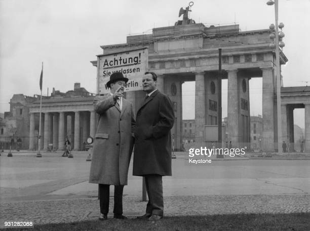 Willy Brandt the Governing Mayor of West Berlin with US Senator Hubert Humphrey in front of the Brandenburg Gate in Berlin Germany 24th November 1958...