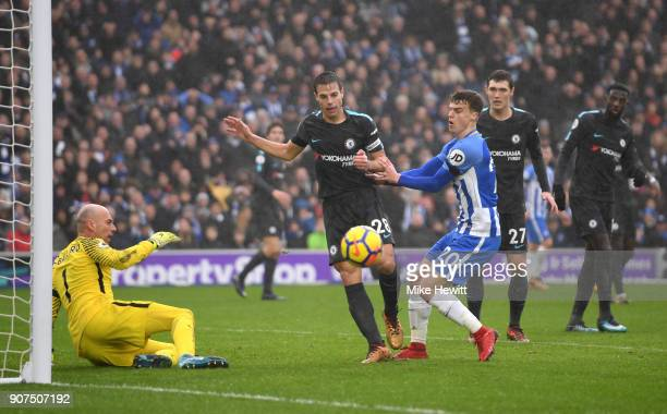 Willy Caballero and Cesar Azpilicueta of Chelsea clear from Solly March of Brighton and Hove Albion during the Premier League match between Brighton...