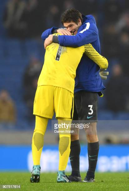 Willy Caballero and Marcos Alonso of Chelsea celebrate victory following the Premier League match between Brighton and Hove Albion and Chelsea at...