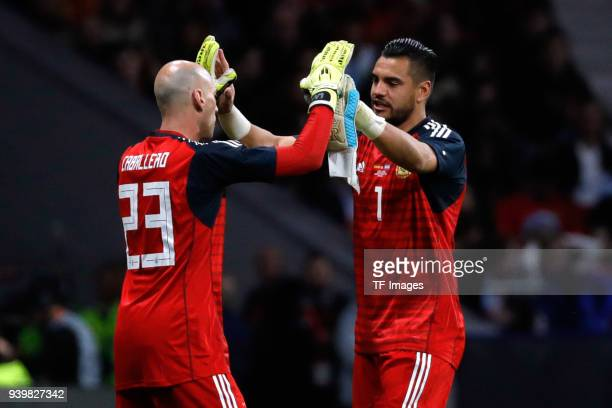 Willy Caballero of Argentina and Sergio Romero of Argentina slap hands during the international friendly between Spain and Argentina at Wanda...