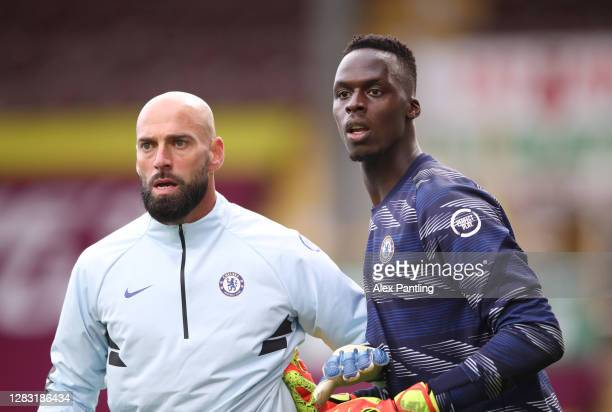 Willy Caballero of Chelsea and Edouard Mendy of Chelsea warm up prior to the Premier League match between Burnley and Chelsea at Turf Moor on October...