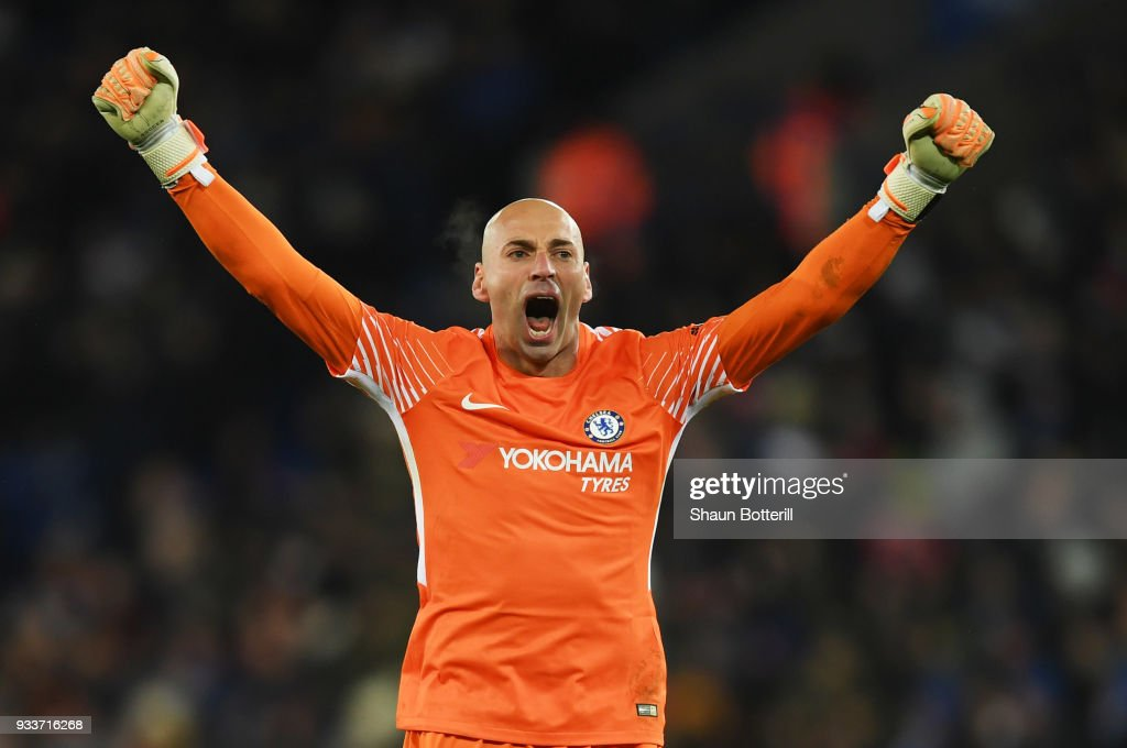 Willy Caballero of Chelsea celebrates as Pedro of Chelsea scores their second goal during The Emirates FA Cup Quarter Final match between Leicester City and Chelsea at The King Power Stadium on March 18, 2018 in Leicester, England.