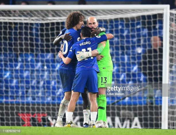 Willy Caballero of Chelsea celebrates victory with David Luiz of Chelsea and Pedro of Chelsea after the Premier League match between Chelsea FC and...