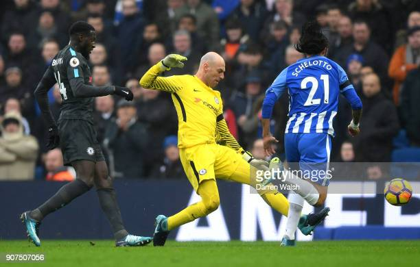 Willy Caballero of Chelsea challenges Matias Ezequiel Schelotto of Brighton and Hove Albion in the penalty area during the Premier League match...
