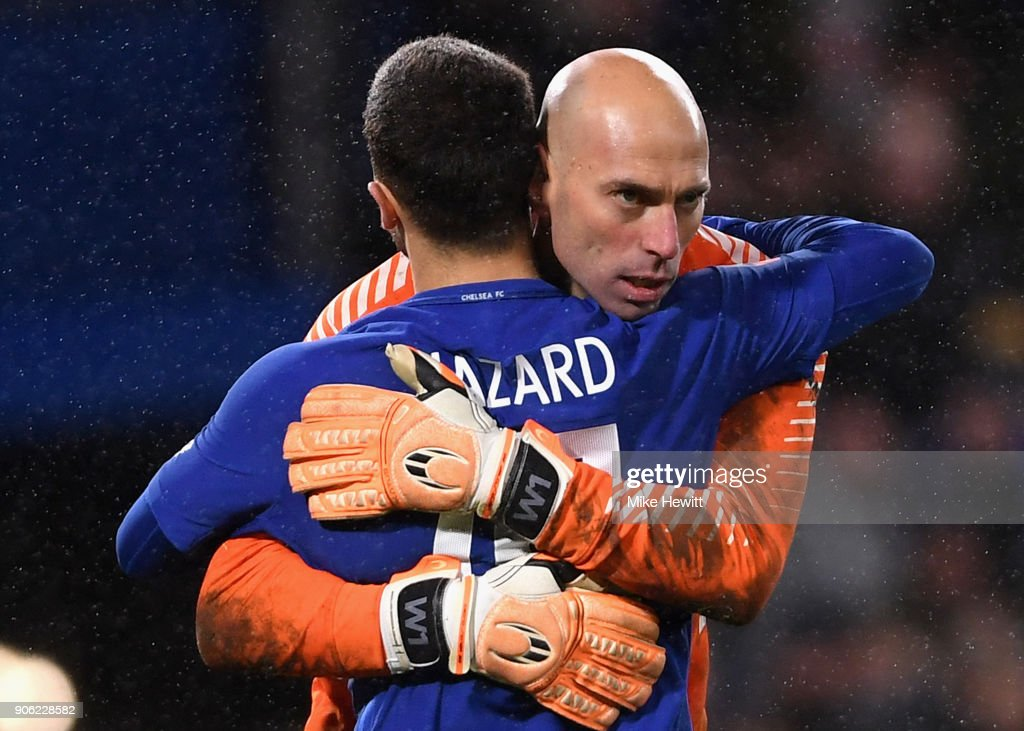 Willy Caballero of Chelsea congratlates Eden Hazard of Chelea after scoring the winning penalty during The Emirates FA Cup Third Round Replay between Chelsea and Norwich City at Stamford Bridge on January 17, 2018 in London, England.