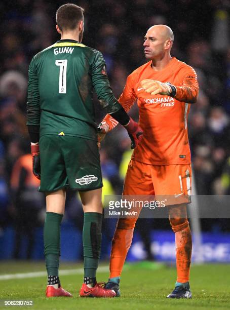 Willy Caballero of Chelsea consols Angus Gunn of Norwich City during The Emirates FA Cup Third Round Replay between Chelsea and Norwich City at...