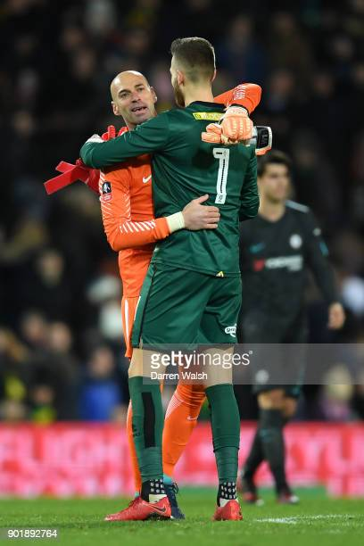 Willy Caballero of Chelsea hugs Angus Gunn of Norwich City after The Emirates FA Cup Third Round match between Norwich City and Chelsea at Carrow...