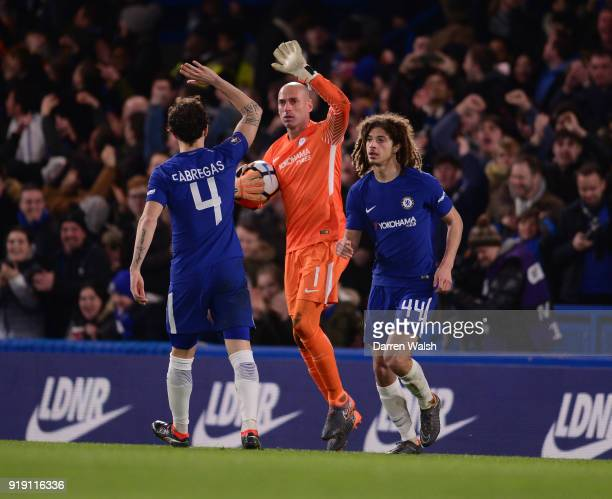 Willy Caballero of Chelsea is congratulated by Cesc Fabregas and Ethan Ampadu during the Emirates FA Cup Fifth Round match between Chelsea and Hull...