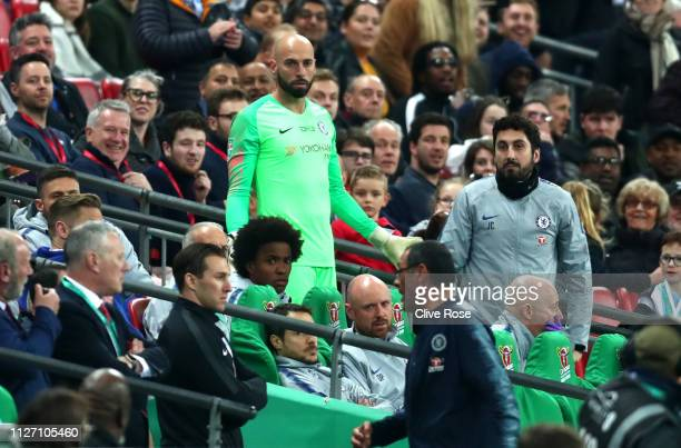 Willy Caballero of Chelsea reacts as Kepa Arrizabalaga refuses to be substituted during the Carabao Cup Final between Chelsea and Manchester City at...