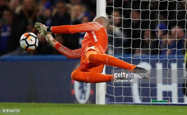 Willy Caballero of Chelsea saves a penalty from David Meyler of Hull during The Emirates FA Cup Fifth Round match between Chelsea and Hull City at...