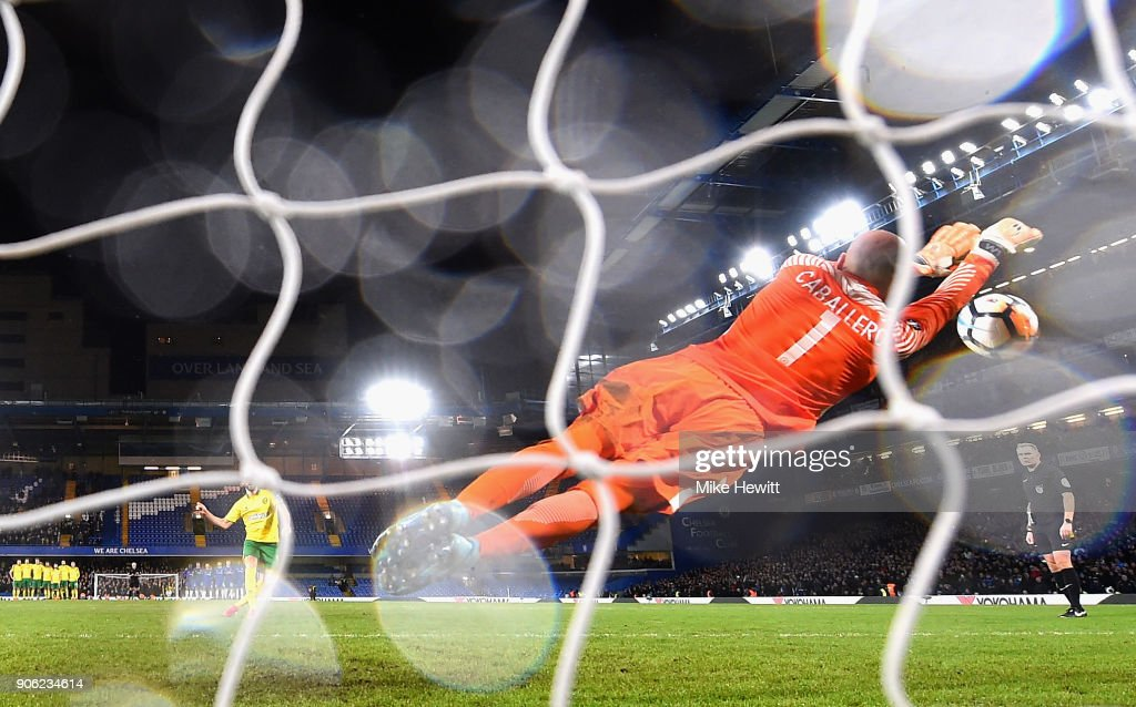 Willy Caballero of Chelsea saves a penalty from Nelson Oliveira of Norwich City during The Emirates FA Cup Third Round Replay between Chelsea and Norwich City at Stamford Bridge on January 17, 2018 in London, England.