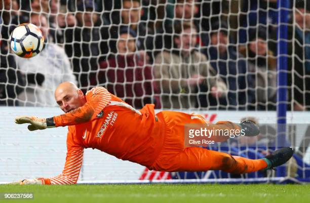 Willy Caballero of Chelsea saves a penalty from Nelson Oliveira of Norwich City during The Emirates FA Cup Third Round Replay between Chelsea and...