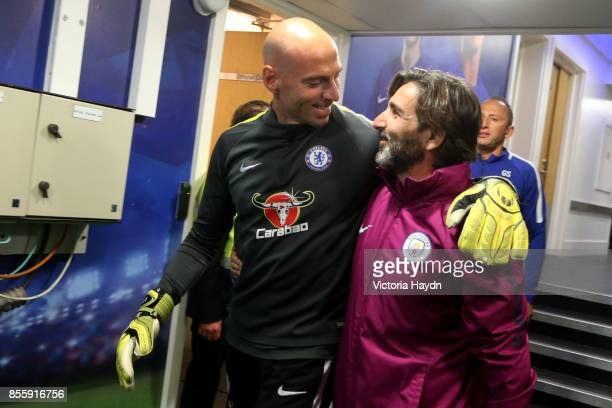 Willy Caballero of Chelsea speaks to a member of the Manchester City coaching team in the tunnel prior to the Premier League match between Chelsea...
