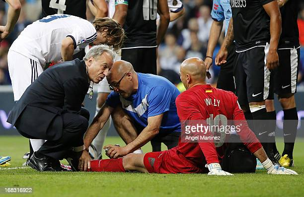 Willy Caballero of Malaga is treated after suffering an injury during the La Liga match between Real Madrid and Malaga at Estadio Santiago Bernabeu...
