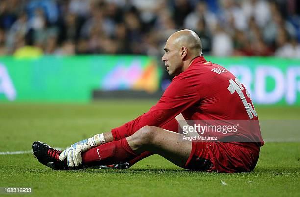 Willy Caballero of Malaga lies injured during the La Liga match between Real Madrid and Malaga at Estadio Santiago Bernabeu on May 8 2013 in Madrid...