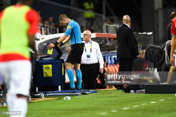 Willy Delajod referee looks VAR during the Ligue 1 match between Montpellier and Rennes at Stade de la Mosson on August 10 2019 in Montpellier France