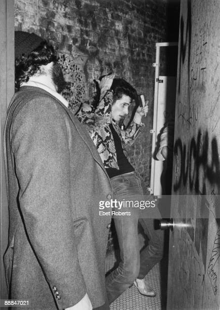 Willy DeVille of Mink Deville does his hair backstage at CBGB's in New York City on May 121977