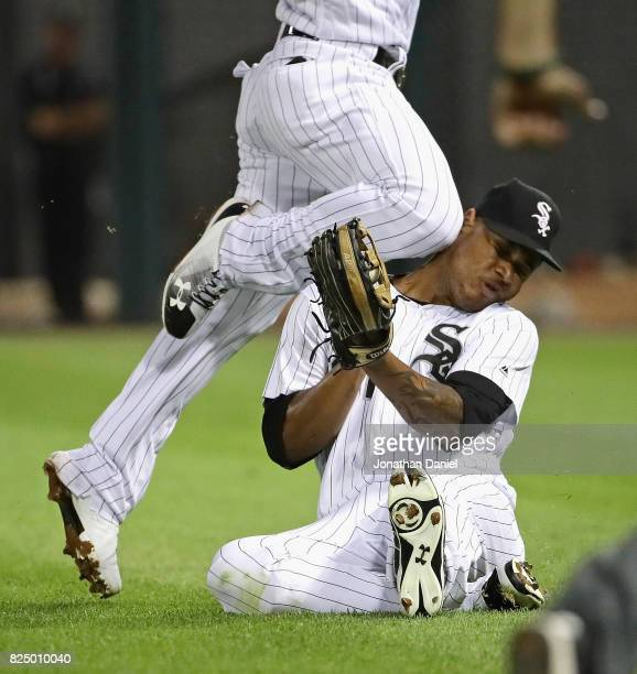 Willy Garcia of the Chicago White Sox is hit in the head by teammate Yoan Moncada as they collide going for a ball hit by Darwin Barney of the...