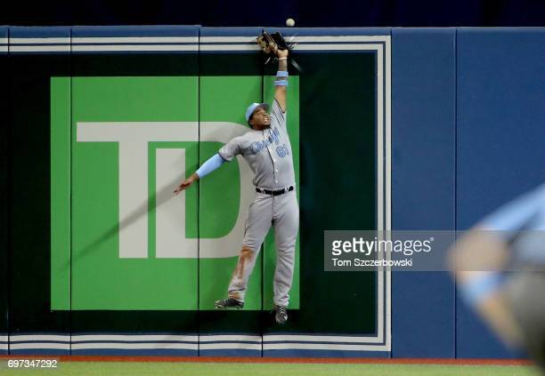 Willy Garcia of the Chicago White Sox jumps but cannot reach a tworun home run by Russell Martin of the Toronto Blue Jays in the sixth inning during...