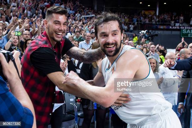 Willy Hernangomez and Sergio Llull of Real Madrid celebrate the victory during the Turkish Airlines Euroleague Play Offs Game 4 between Real Madrid v...