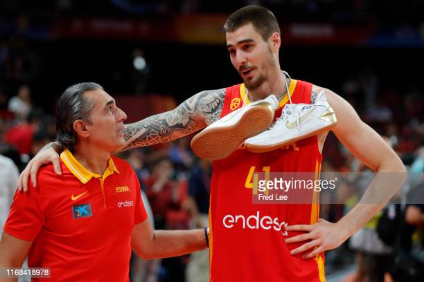 Willy Hernangomez Geuer and Head coach Sergio Scariolo of Spain celebrate their victory during the cup ceremony after the FIBA World Cup 2019 against...