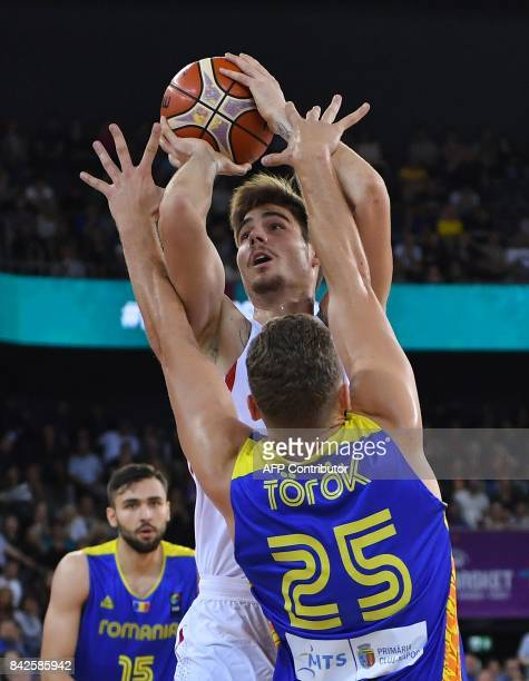 Willy Hernangomez of Spain vies with Rolland Torok of Romania during Group C of the FIBA Eurobasket 2017 mens basketball match between Spain and...