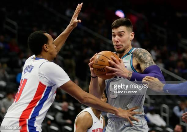 Willy Hernangomez of the Charlotte Hornets drives against John Henson of the Detroit Pistons during the first half at Little Caesars Arena on...