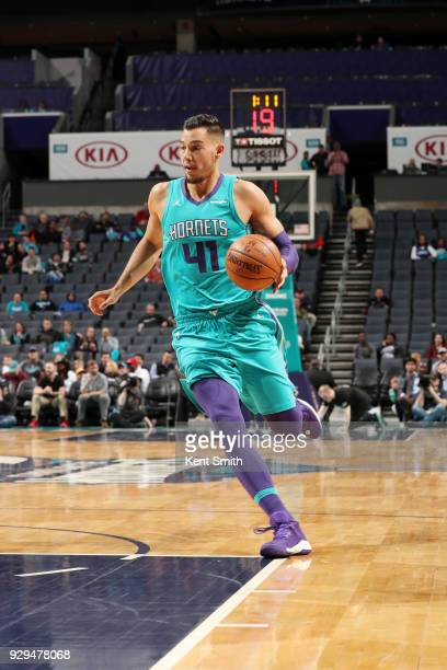 Willy Hernangomez of the Charlotte Hornets handles the ball against the Brooklyn Nets on March 8 2018 at Spectrum Center in Charlotte North Carolina...