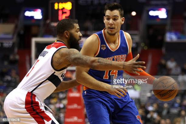 Willy Hernangomez of the New York Knicks dribbles in front of Markieff Morris of the Washington Wizards during the first half at Verizon Center on...