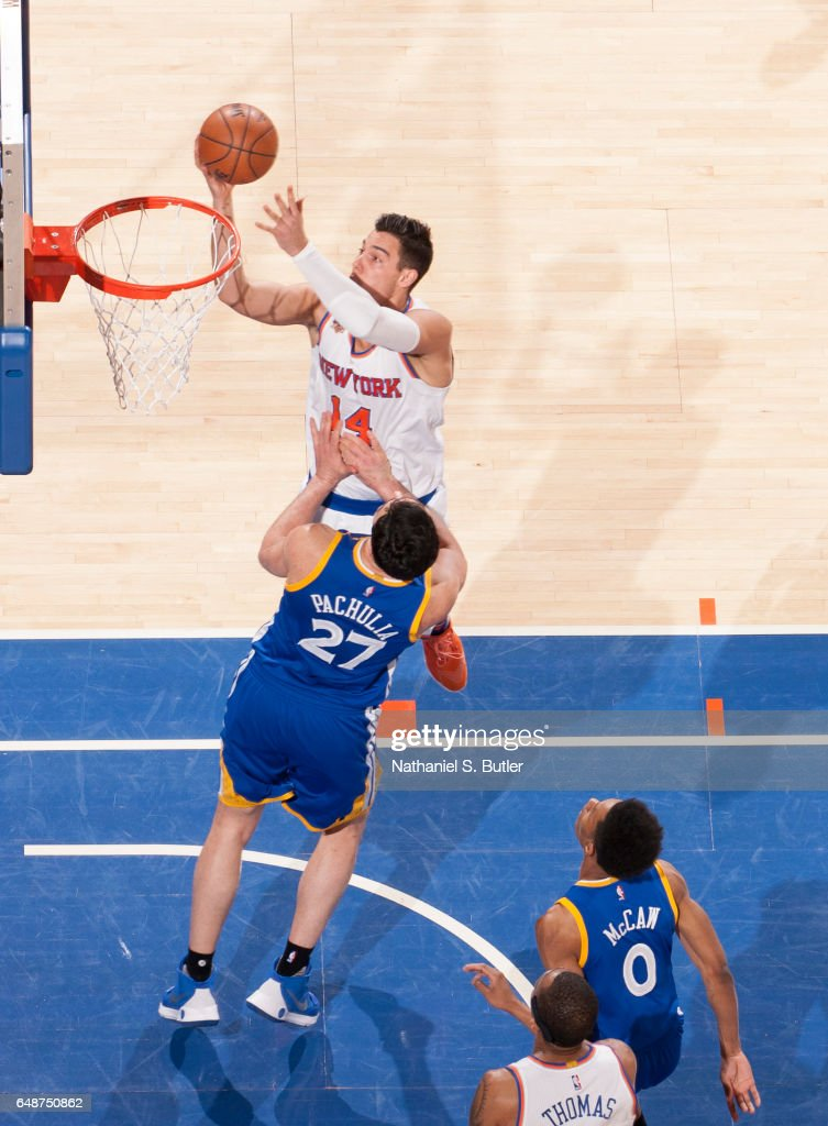 Willy Hernangomez #14 of the New York Knicks drives to the basket against the Golden State Warriors on March 5, 2017 at Madison Square Garden in New York City, New York.