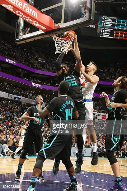 Willy Hernangomez of the New York Knicks dunks against Roy Hibbert of the Charlotte Hornets during the game on November 26 2016 at Spectrum Center in...