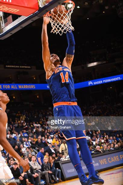 Willy Hernangomez of the New York Knicks dunks the ball against the Golden State Warriors on January 23 2018 at ORACLE Arena in Oakland California...