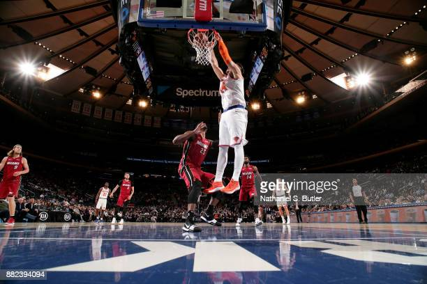 Willy Hernangomez of the New York Knicks dunks the ball during the game against the Miami Heat on November 29 2017 at Madison Square Garden in New...