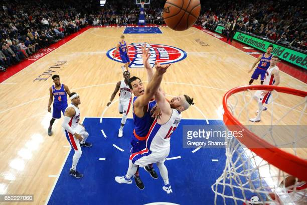 Willy Hernangomez of the New York Knicks gets a second half shot off past Aron Baynes of the Detroit Pistons at the Palace of Auburn Hills on March...