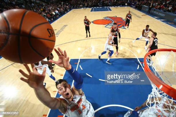 Willy Hernangomez of the New York Knicks grabs a rebound against the Portland Trail Blazers on November 27 2017 at Madison Square Garden in New York...